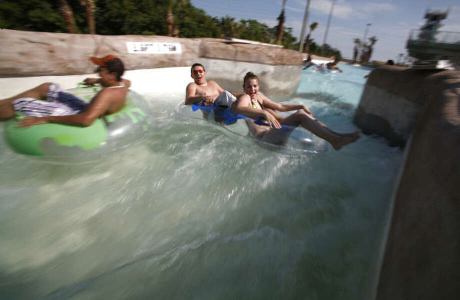 The White Water River, one of seven new attractions at Schlitterbahn Galveston Island Waterpark, gets a pre-opening run-through Wednesday. Photo: Steve Ueckert, Houston Chronicle