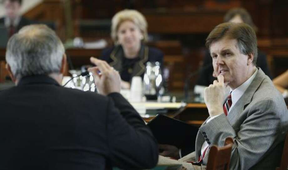 Sen. Dan Patrick, R-Houston, right, at the Senate on Tuesday, said he hopes women connect with their unborn children by seeing their fetus on an ultrasound. Photo: Harry Cabluck, ASSOCIATED PRESS