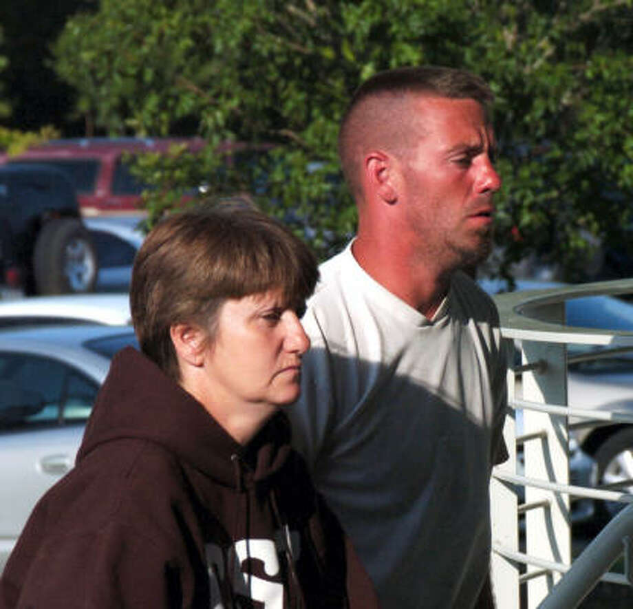 Aaron Pilcher is escorted by his mother Annette Pilcher into the emergency department at Angleton Danbury hospital after being rescued early Friday. He and a friend survived two nights in the Gulf after a boat sank. Photo: Kirk Sides, For The Chronicle