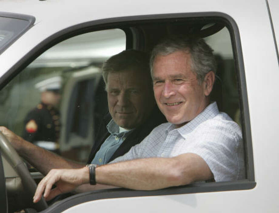 President Bush drives NATO Secretary General Jaap de Hoop Scheffer back to Crawford Ranch in his pickup after the diplomat's arrival on Sunday. Photo: Lawrence Jackson, AP