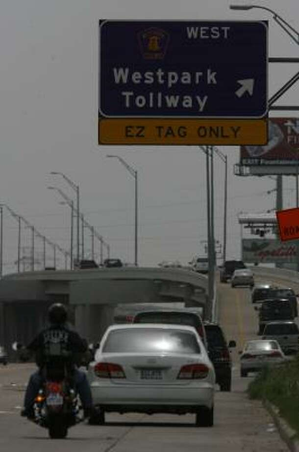 It now costs $2.35 to drive the 14 miles of the Westpark Tollway in Harris County. The price would have gone up to $5.50 during peak hours. Photo: MELISSA PHILLIP, CHRONICLE