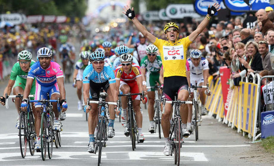 Fabian Cancellara celebrates as he crosses the finish line of the third stage of the 94th Tour de France. Photo: FRANCK FIFE, AFP/Getty Images