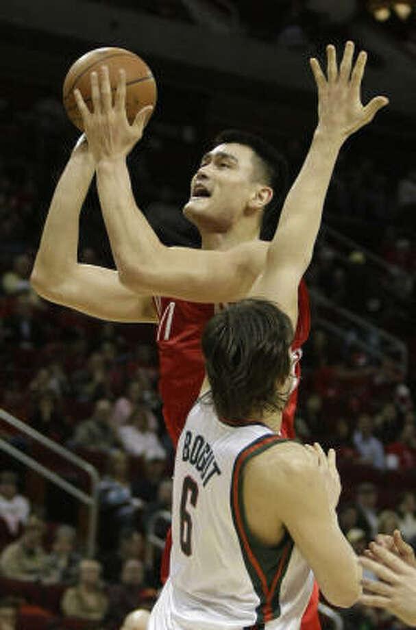 Rockets center Yao Ming shoots over Milwaukee Bucks center Andrew Bogut during the second quarter. Photo: Brett Coomer, Chronicle