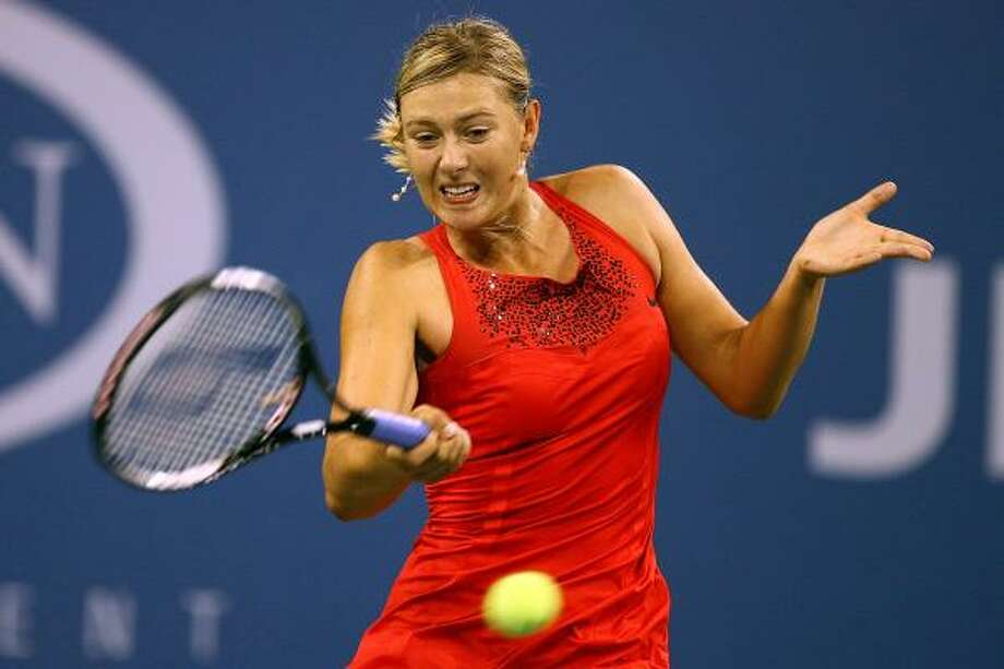 Russian star Maria Sharapova compiled 15 winners before 51st-ranked Roberta Vinci of Italy hit her first and finished with a 30-3 edge in that category during the 6-0, 6-1 victory Tuesday. Photo: Al Bello, Getty Images