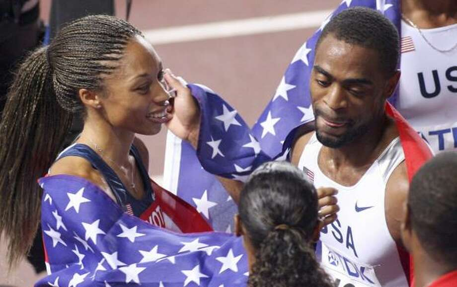 Sprinters Allyson Felix, left, and Tyson Gay celebrate after their gold-medal performances in Osaka, Japan. Photo: KAZUHIRO NOGI, AFP/GETTY IMAGES