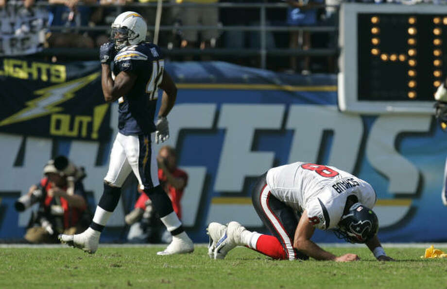 Matt Schaub lies on the ground after taking a helmet-to-helmet hit during an interception return in last Sunday's game in San Diego. Photo: Mark J. Terrill, AP