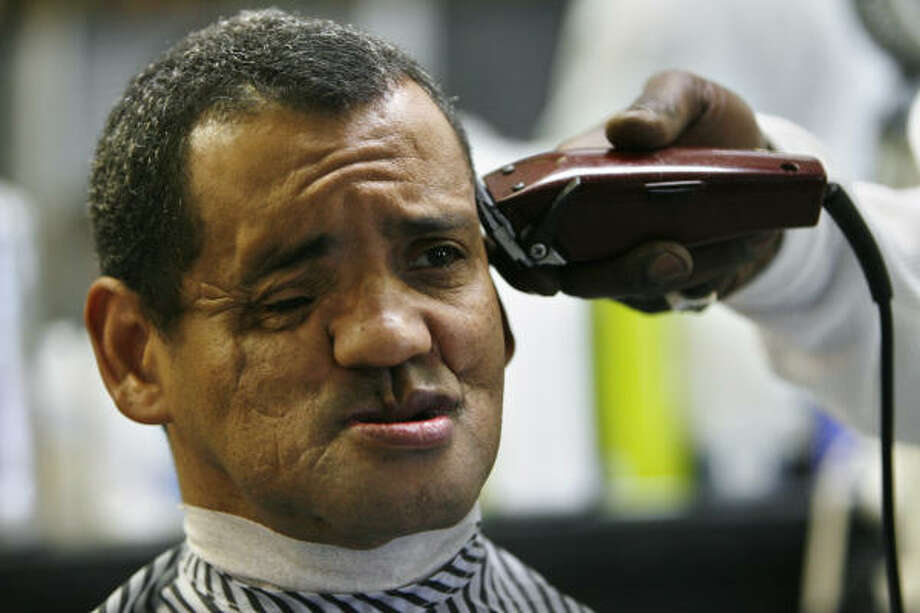 Before meeting with the surgeon who will lead the effort to reconstruct his face, Ricardo Rachell treats himself to his first haircut as a free man in Houston Dec. 30. Photo: Eric Kayne, Chronicle