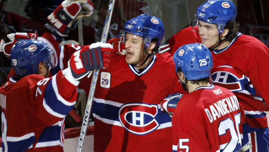 The Canadiens Mark Streit, center, celebrates his goal with teammates in a win over the Senators. Photo: Ryan Remiorz, AP