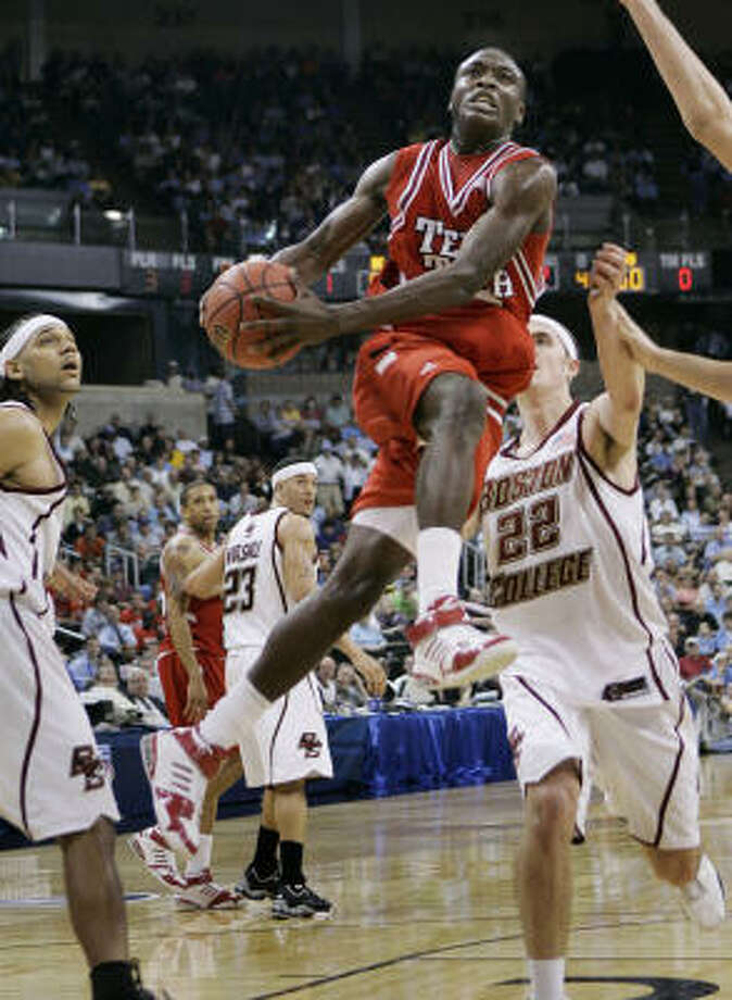 Texas Tech's Martin Zeno splits Boston College's Tyler Roche (22) and Sean Marshall as he drives to the basket during Thursday's East Regional game at Winston-Salem, N.C. Zeno led the Red Raiders with 21 points. Photo: David J. Phillip, AP