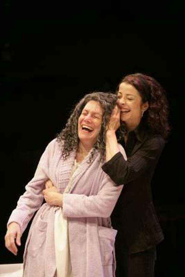 Karmin Murcelo, left, as Ana and Josie de Guzman as Mathilde share a lught during the Alley's production of Sarah Ruhl's The Clean House. Photo: T Charles Erickson, Alley Theatre