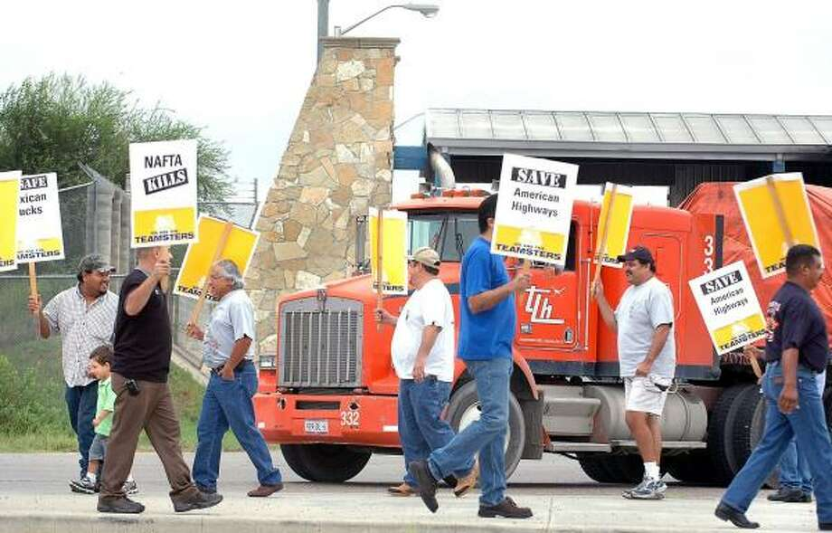 Demonstrators protest near the World Trade Bridge in Laredo on Thursday. They oppose allowing a limited number of Mexican trucks unrestricted access to U.S. highways. Photo: RICARDO SANTOS, LAREDO MORNING TIMES