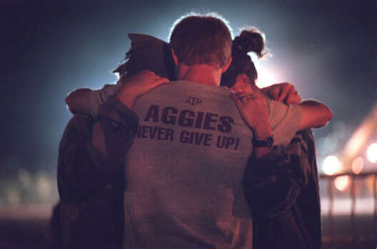 Texas A&M students embrace and pray at the site of the collapsed Bonfire in College Station. Photo: Smiley N. Pool, Chronicle File