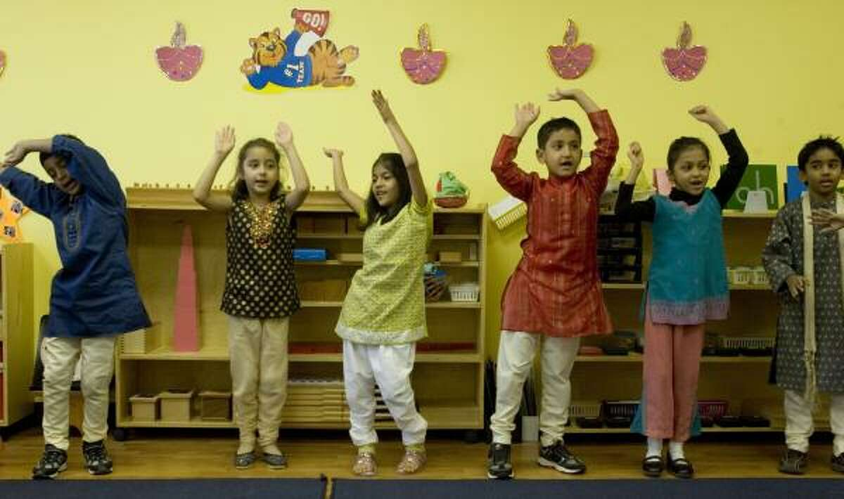 Kindergarteners and first-graders at the DAV Montessori School in west Houston practice their dance for the Hindu holiday of Diwali. Many students say fireworks are the highlight, but they still keep in mind the meaning behind it.