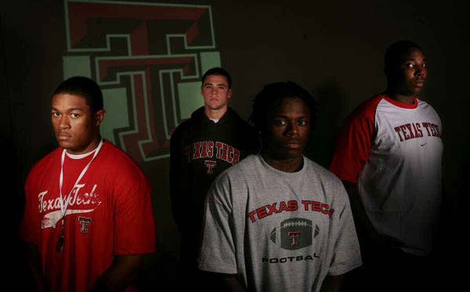 Joining Mike Leach's team are Tyrone Sonier, (back), Jonathan LaCour, Jared Flannel and Mickey Okafor. Photo: Mayra Beltran, Chronicle