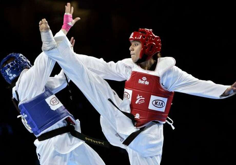 The Olympic teakwondo selection process for Diana Lopez, right, and other female athletes has come under criticism. Photo: MANU FERNANDEZ, ASSOCIATED PRESS