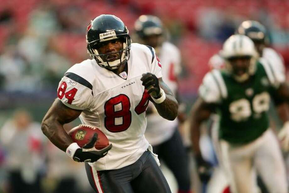 Former Texans receiver Eric Moulds, who signed with Tennessee on Wednesday, has caught at least 57 passes in each of the last nine seasons. Photo: Chris McGrath, Getty Images