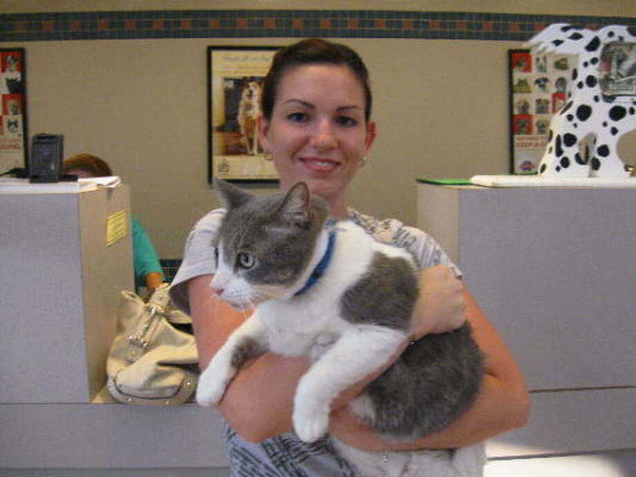Melissa Thomas is reunited with her cat Taitus at the Houston SPCA. Photo: Houston SPCA