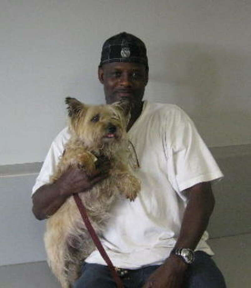 Charles Green is reunited with his dog Lillie at the Houston SPCA. Photo: Houston SPCA