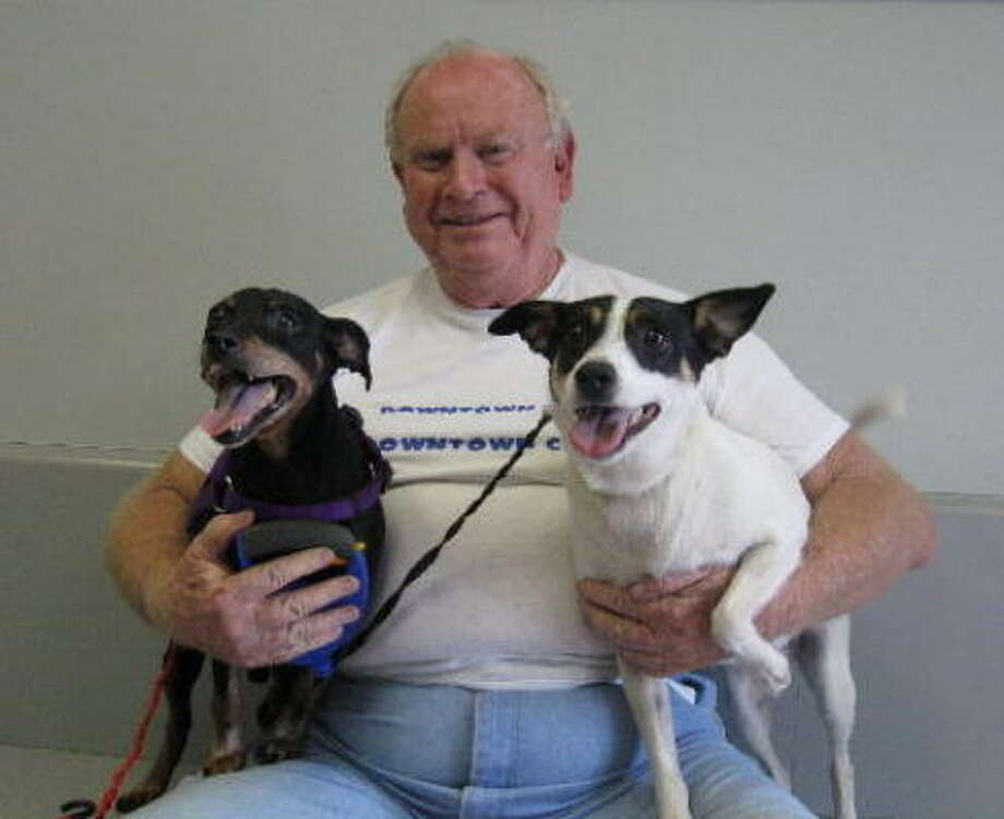 Don Bassey is reunited with his dogs Elmo and Alexis at the Houston SPCA. Photo: Houston SPCA