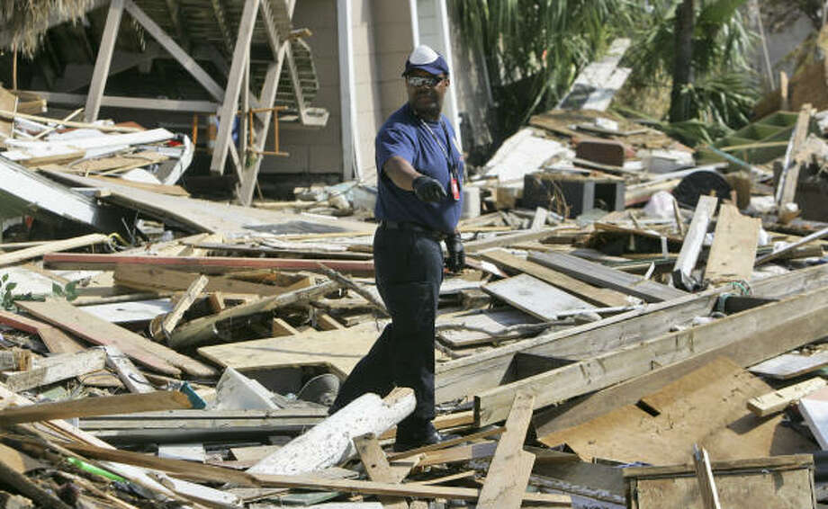 Tiren McDaniel, of the SPCA of Los Angeles scans a neighborhood for pets in a neighborhood destroyed by Hurricane Ike in Galveston Sept. 18. Photo: LM Otero, AP