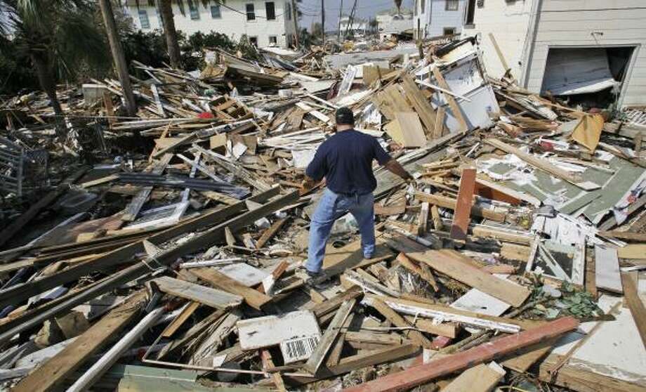 Ernest Coronel, of the SPCA of Los Angeles, Calif., searches for pets in a neighborhood destroyed by Hurricane Ike in Galveston Sept. 18. Photo: LM Otero, AP