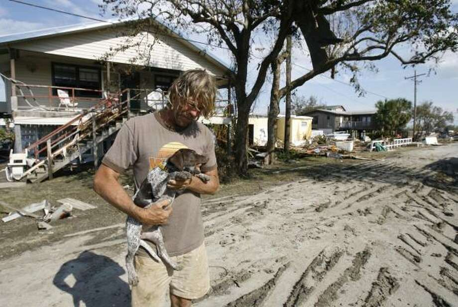 Norbert Kurtz and his dog rode out Hurricane Ike in his wooden house on the Bolivar Peninsula. Photo: Nick De La Torre, Chronicle