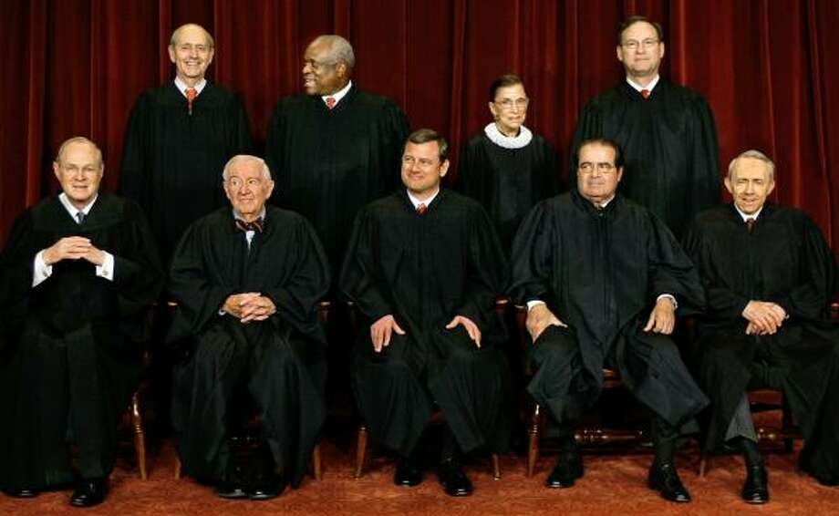 Justice Anthony Kennedy, bottom left, and the rest of his colleagues on the U.S. Supreme Court are set to begin the term with a mix of cases that will test the court's ideology. Photo: J. SCOTT APPLEWHITE, ASSOCIATED PRESS
