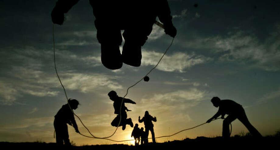 Feb. 9 | Palestinian children play at sunset. | Ramallah, West Bank Photo: MUHAMMED MUHEISEN, AP