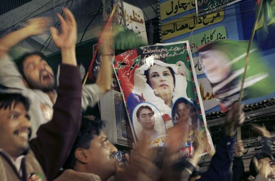 Feb. 16 | Supporters of the Pakistan Peoples Party hold banners bearing the image of slain party leader Benazir Bhutto at the final campaign rally before Pakistanis voted in the Feb. 18 parliamentary elections. The PPP and another opposition party won the majority of seats. | Rawalpindi, Pakistan Photo: Wally Santana, AP