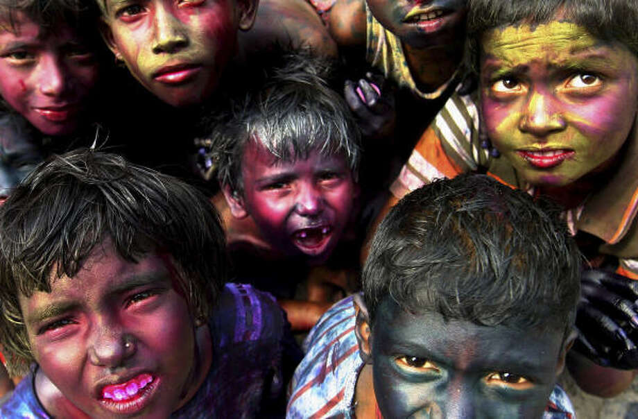 March 21 | Children participate in Holi, the Spring Festival of Colors. | Calcutta, India Photo: Sucheta Das, AP