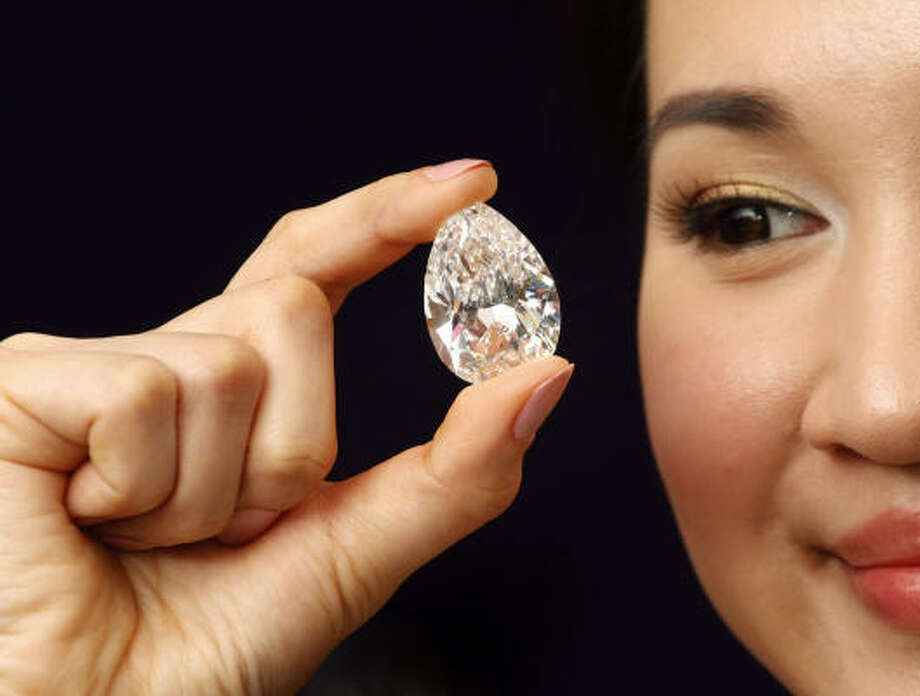 March 31| A flawless, pear-shaped, D-colour, 72.22-carat diamond is displayed during a Sotheby's Auction press preview. The diamond is estimated to be worth between $10 million and $13 million. | Hong Kong Photo: Vincent Yu, AP