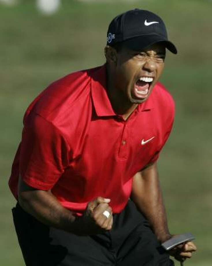 June 15| Tiger Woods reacts after sinking a birdie putt on the 18th green during the fourth round of the U.S. Open championship at the Torrey Pines Golf Course. The shot forced a playoff against Rocco Mediate. Woods went on to win.  | San Diego, California Photo: Lenny Ignelzi, AP