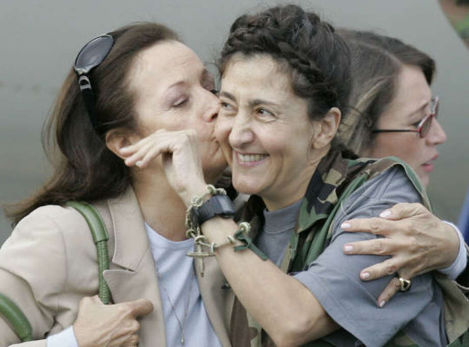 July 2| Former FARC hostage Ingrid Betancourt is kissed by her mother Yolanda Pulecio after being rescued from six years of captivity. Betancourt, who was abducted while running for president, was one of 15 hostages rescued in a daring covert operation. | Bogota, Columbia Photo: Ricardo Mazalan, AP