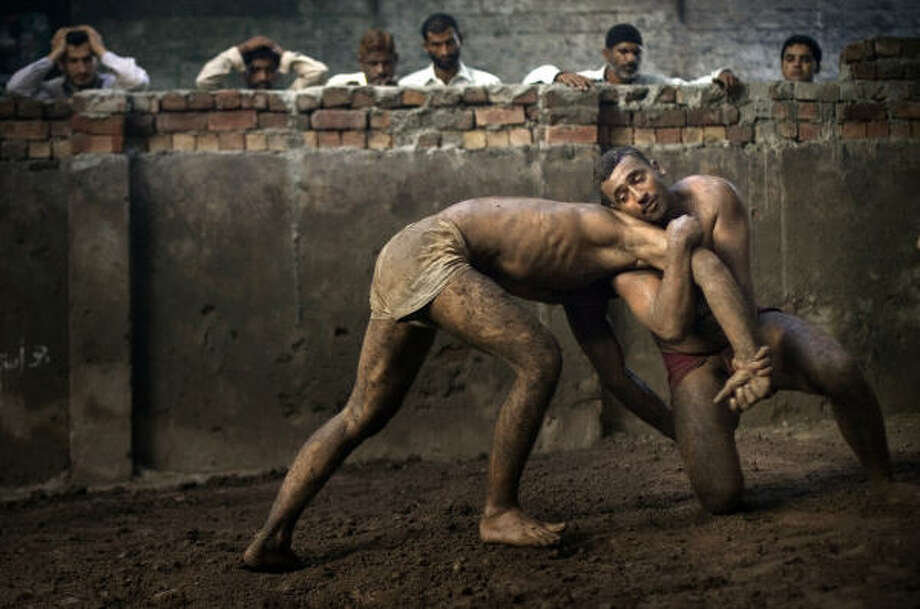 Aug. 2| Kushti wrestlers train at the Champion Khalu Behalwan wrestling club. | Lahore, Pakistan Photo: Emilio Morenatti, AP
