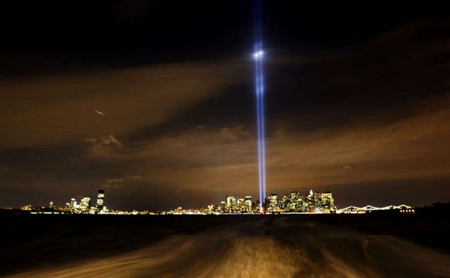 "Sept. 11 | The New York skyline is punctuated by the ""Tribute in Lights,"" which represent the towers of the World Trade Center. 