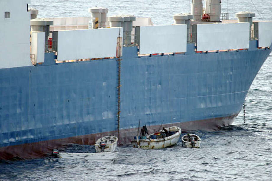 Sept. 25| A U.S. Navy photo shows Somali pirates hijacking the MV Faina, a Belize-flagged cargo ship carrying supposed Kenyan military weapons. The pirates demanded $20 million in ransom despite being surrounded by three foreign warships. | off the Somali coast Photo: HO, AFP/Getty Images