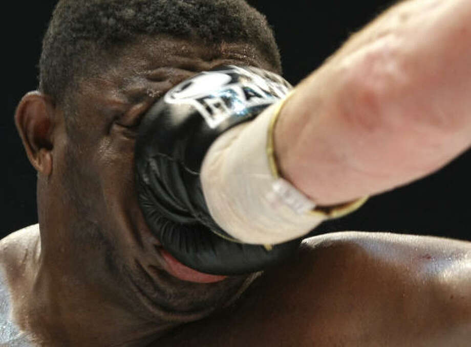 Oct. 11  | Samuel Peter from Nigeria gets a punch from Vitali Klitschko of Ukraine during their WBC heavyweight boxing world championship fight. Klitschko won the fight after round nine due to a technical knock out.  | Berlin, Germany Photo: Herbert Knosowski, AP