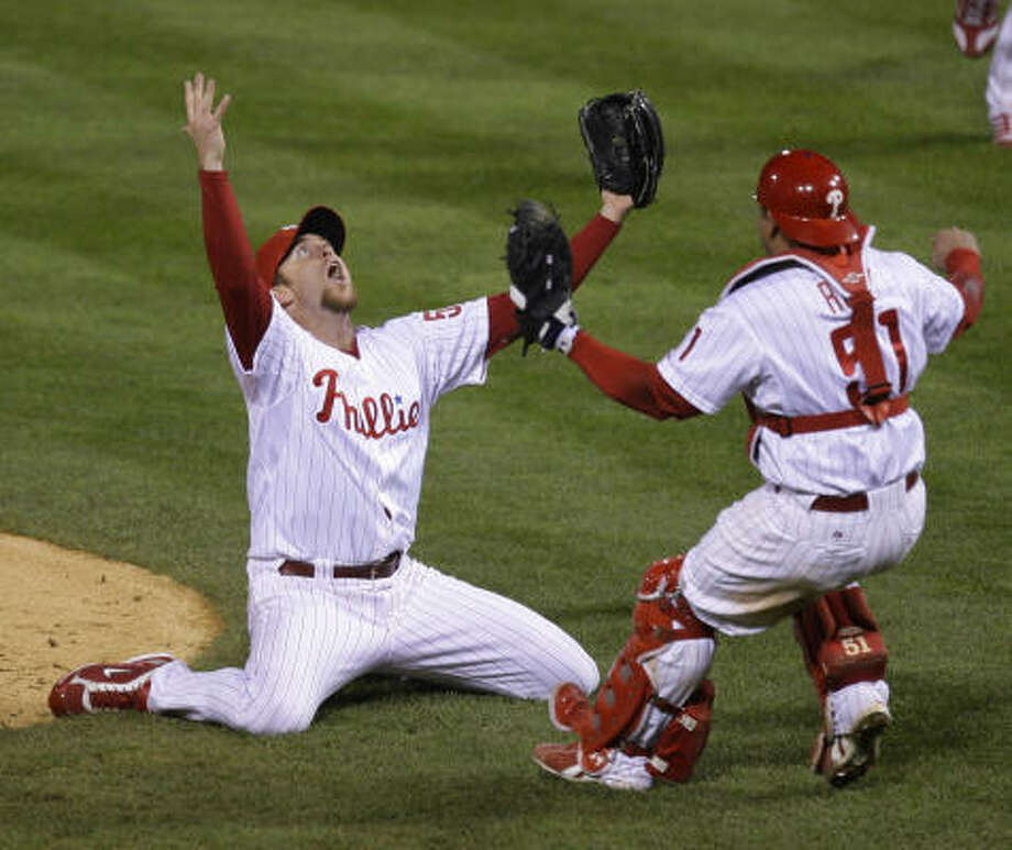 Oct. 29 | Philadelphia Phillies players Brad Lidge, left, and Carlos Ruiz react after their victory in Game 5 of the World Series. The Phillies defeated the Tampa Bay Rays 4-3 to win the series. | Philadelphia, Pennsylvania Photo: Julie Jacobson, AP