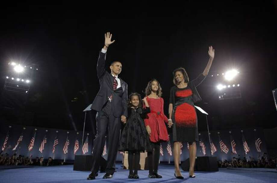 Nov. 4 | President-elect Barack Obama, wife Michelle and daughters Malia, 7, and Sasha, 10, wave to the crowd at his election night rally. | Chicago, Illinois Photo: Jae C. Hong, AP