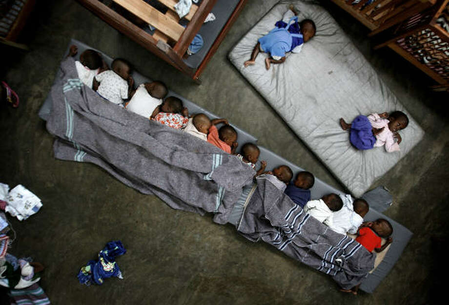 Nov. 13| Orphans and lost children rest at the Don Bosco Ngangi center. | Goma, eastern Congo Photo: Jerome Delay, AP