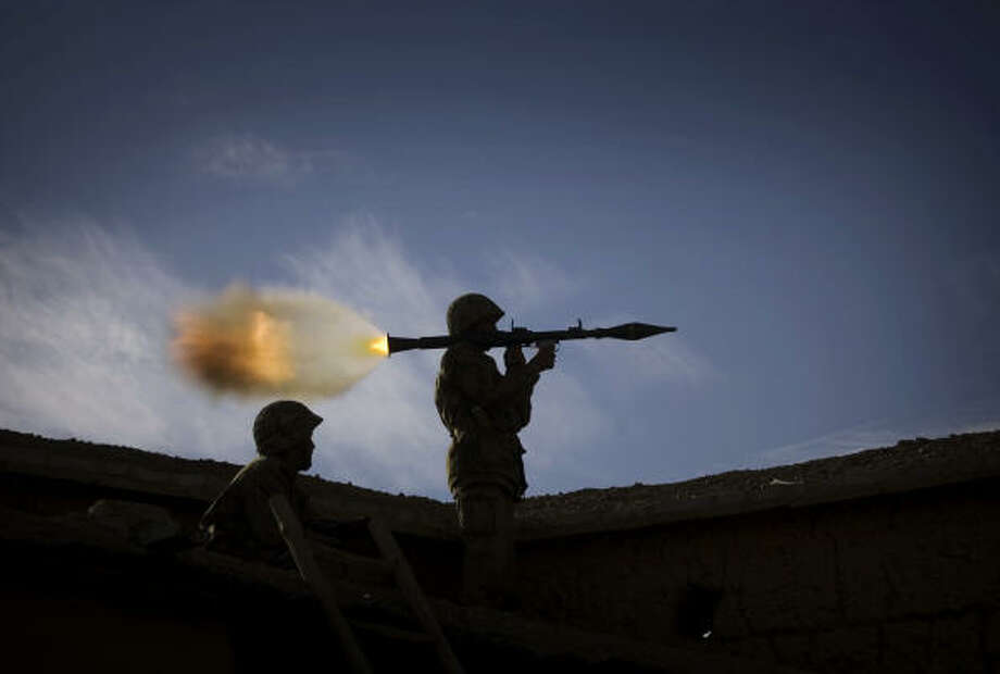 Nov. 28 | A Pakistani soldier fires his Rocket Propelled Grenade toward suspected militant positions from the top of a house on the border of Afghanistan and Pakistan. | Sabagai village, Bajur tribal region Photo: EMILIO MORENATTI, AP