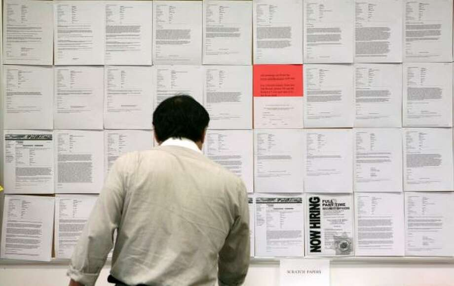 Dec. 5 |  A man looks at job listings at the Employment Development Department. November saw some of the worst monthly job loses in the U.S. in decades. |  San Francisco, California Photo: Jeff Chiu, AP