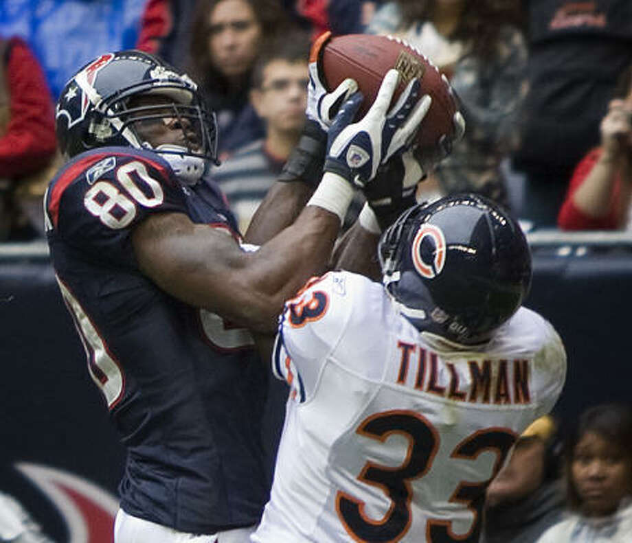Dec. 28, Texans 31, Bears 24:Andre Johnson finished the season with a bang after being shut down by the Raiders in Week 16. He caught 10 passes for 148 yards and two touchdowns, including one he grabbed out of the hands of Bears cornerback Charles Tillman. He finished the season leading the NFL in receptions (115) and yards (1,575) to go with eight touchdowns. Photo: Brett Coomer, Chronicle