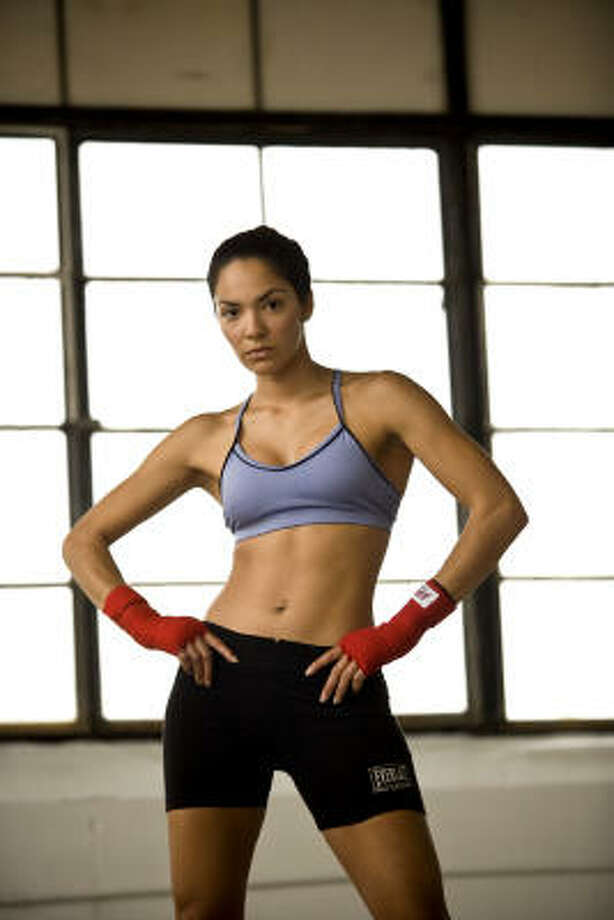 Sarah Ponce, champion kickboxer, on her workout routine:``I'm a bit neurotic. I do weight lifting, kayaking, hiking, running, swimming and hours and hours of ping pong. I'm all over the place. I like having flexibility, strength and endurance.'' Photo: Robert Seale, For The Chronicle
