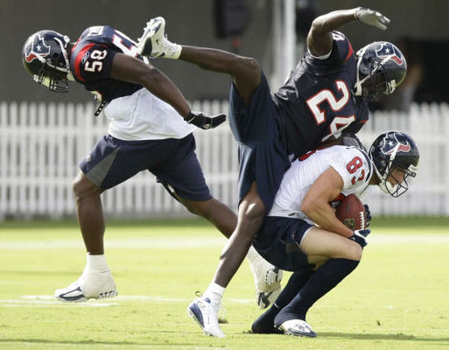 July 30:Texans safety C.C. Brown (24)and  receiver Kevin Walter (83) collide as linebacker Rosevelt Colvin runs behind the play. Walter made the catch. Photo: Brett Coomer, Chronicle