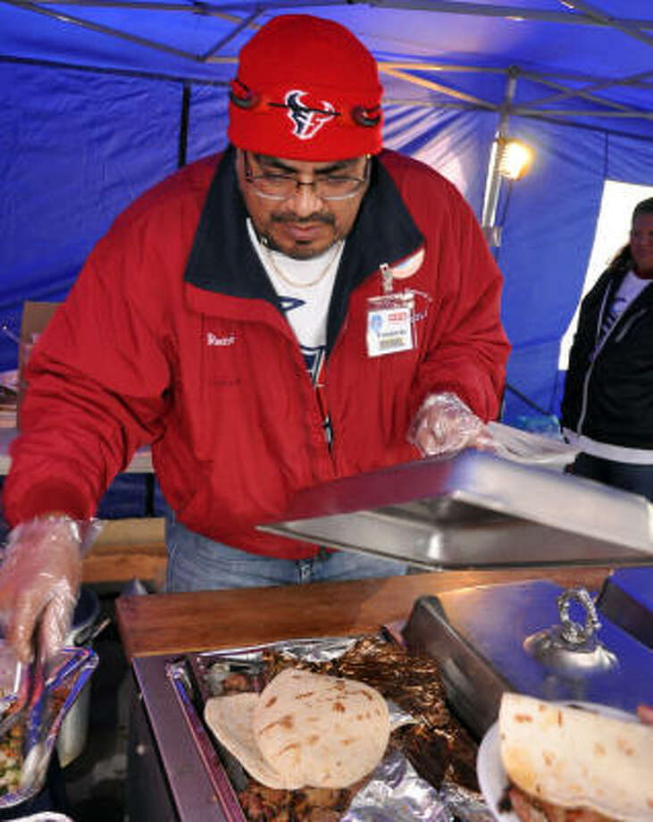 Budweiser Plaza, Bears vs. Texans, Dec. 28:The guy serving the fajita meet never has problems finding friends on gameday. Venancio Villagrona is one of the most popular guys under the E-5 Tailgaters tents. Photo: Chris Elliott, For The Chronicle