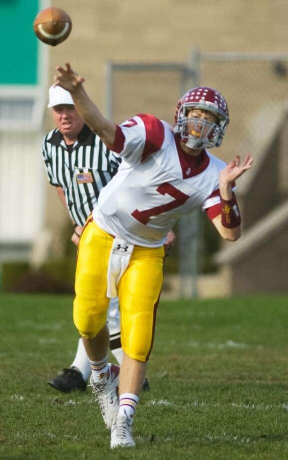 St. Joseph High School's quarterback Joe Della Vecchia throws a pass against Trinity Catholic High School in football action at Trinity. Photo: Kathleen O'Rourke / Stamford Advocate