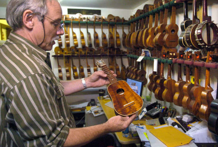 Bart Wittrock, owner of the music store Rockin' Robin Guitars and Music, owns about 200 ukulele's 100 of which he considers collectables worth for $2,500 to $10,000. Photo: Johnny Hanson, For The Chronicle
