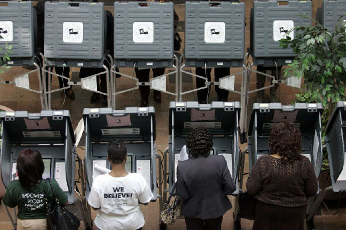 A group of early voters cast their vote at the Acres Homes Multi-Service Center Sunday.