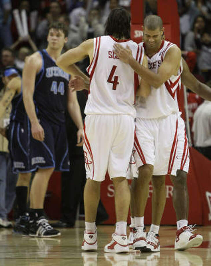 Rockets 120, Jazz 115 Rockets forward Shane Battier and Houston Rockets forward Luis Scola (4) embrace as Utah Jazz center Kyrylo Fesenko (44) walks off the court after the Rockets beat the Jazz in overtime. Photo: Brett Coomer, Chronicle